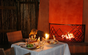 Dining at the fireplace at Thanda Private Game Reserve
