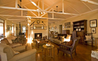 The lounge and fireplace at Three Trees at Spioenkop