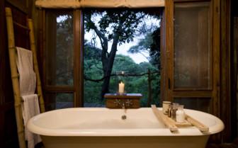 Bathroom with bathtub at lake Manyara Tree Lodge, luxury Lodge in Tanzania