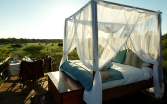 The treehouse bed at Lion Sands, luxury hotel in South Africa