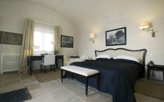 The bedroom at Masseria Torre Maizza, luxury hotel in italy