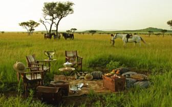 Bush picnic at Singita Sabora Tented Camp, luxury camp in Tanzania