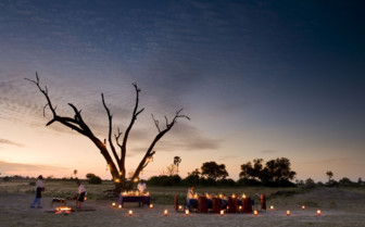 Outdoor dining experience at  Selinda Camp, luxury camp in Botswana