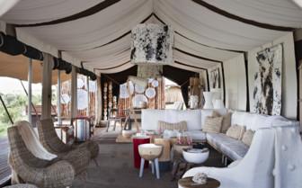 The lounge area at Singita Mara River Tanted Camp, luxury camp in Tanzania