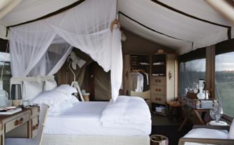Interior of a tent at Singita Mara River Tented Camp