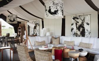 The lounge area at Singita Mara River Tented Camp, luxury camp in Tanzania