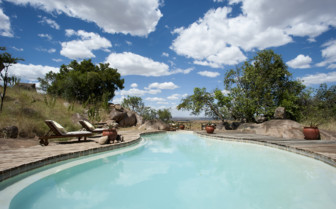 The swimming pool at Lamai Serengeti, luxury camp in Tanzania