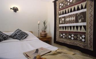 The bedroom at Ndutu Safari Lodge