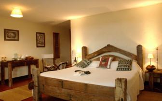 Luxury bedroom at Ndutu Safari Lodge, luxury lodge in Tanzania