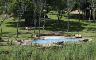 The swimming pool at Horizon Horseback Safari Lodges