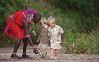 Maasai man with children