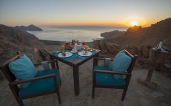 Sunrise breakfast at the beach at Six Senses Zighy Bay hotel