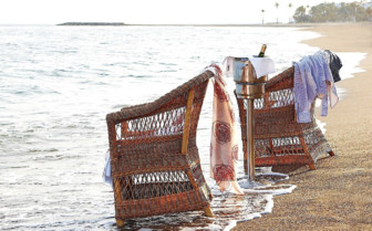 Chairs at the water