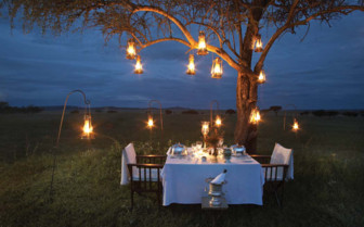 Romantic outdoor dinner at Singita Sabora Tented Camp