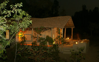 The hotel exterior at night