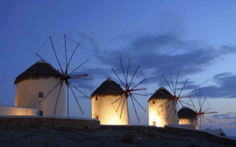Greek Windmills Against the Darkening Sky