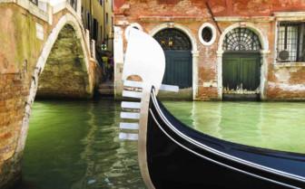 Gondola drifting under bridge