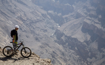 A Cyclist Overlooking the Hajar Mountain Range