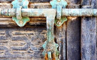 A Rusted Green Door Handle in Spain
