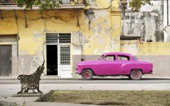 Pink car on street in Cuba