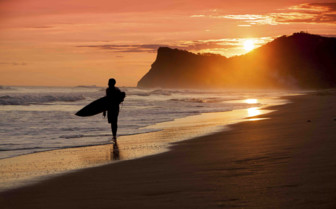 Surfer on Sunset Beach