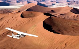 Plane over dunes at Scheoneman Skeleton Coast Flying Safaris, luxury camp in Namibia
