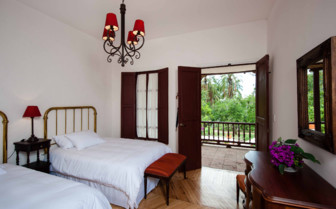 A Twin Bedroom at Hacienda Piman