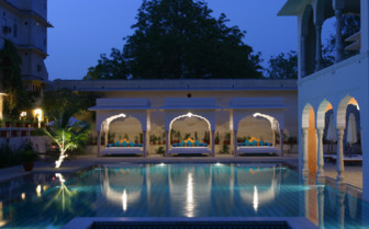 The swimming pool at Samode Haveli, luxury hotel in India