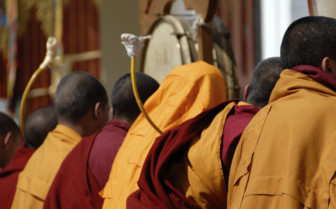Monks seated and Praying