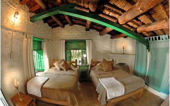 Twin bedroom at Kumaon Village Houses