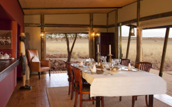 Dinner at Wolwedans Private Camp, luxury camp  in Namibia