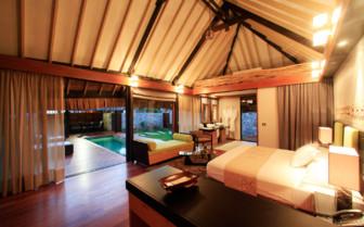 Bedroom of a garden villa suite