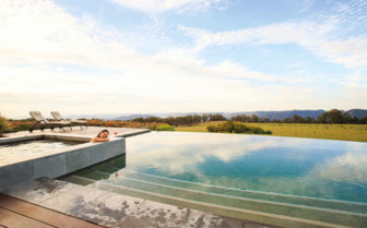 Relaxing in the infinity swimming pool