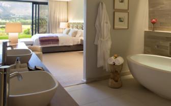 Ensuite bedroom with bath tub