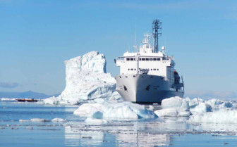 Akademik boat next to iceberg