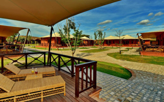 Bagan Lodge exterior and loungers