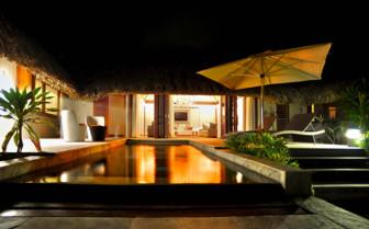 Pool Beach villa exterior at night