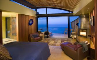 Bedroom with ocean views at Post Ranch Inn