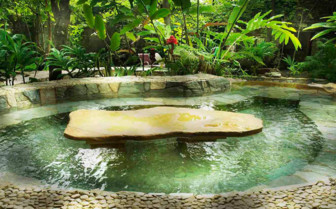 The pond in the garden at Quinta Chanabnal, luxury hotel in Mexico