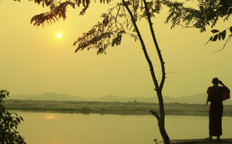 Monk looking over the Irrawaddy river
