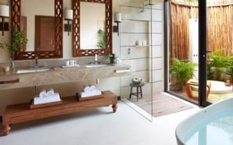 Oceanfront bathroom with outdoor shower