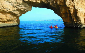 Kayaking under the arch