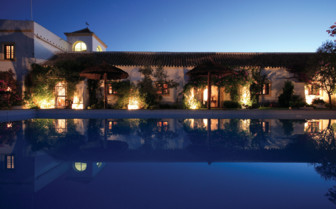 Exterior with pool at night