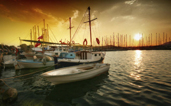 Sunset over Boats in Harbour