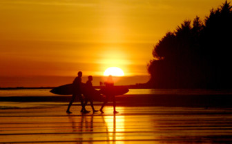 Surfers leaving the Beach at Sunset in Tofino