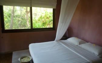 Bedroom at Knai Bang Chatt, luxury hotel in Cambodia