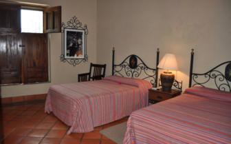 Bedroom at Posada Hidalgo luxury hotel in Mexico
