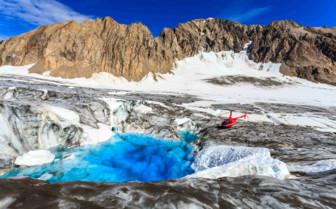 Helicopter lands at a Glacier Pool in Alaska