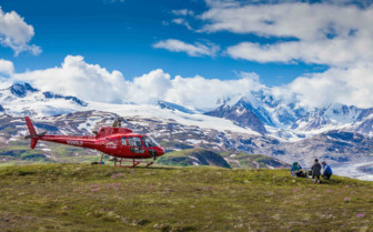 Helicopter Lands atop a Mountain in Alaska