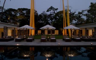 Pool area at night at Amansara hotel